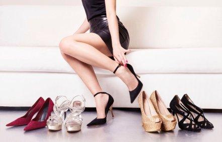 Woman with beautiful legs choosing shoes.